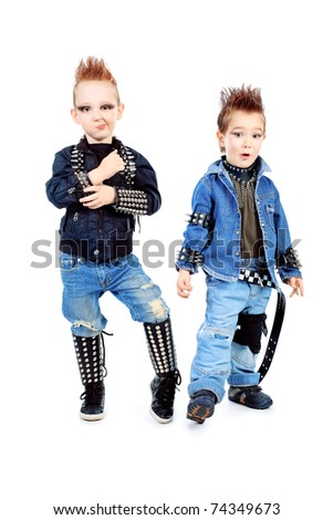 Shot of two little boys singing rock music in studio. Isolated over white background.