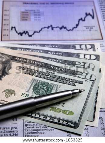 Shot of US currencies and a newspaper showing a financial chart - stock photo
