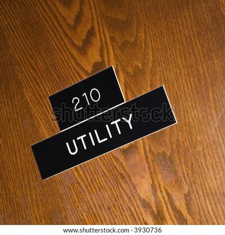 Shot of utility sign on wooden door. - stock photo