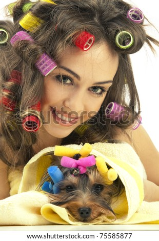 Shot of young adult female with Yorkshire Terrier dog after shower - stock photo