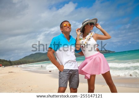 Shot of young couple enjoying beach getaway. Couple in love, summer luxury vacation in Hawaii. Travel, romantic holidays concept. Enjoying every minute of this vacation. - stock photo