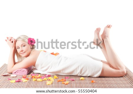 Shot of young sexy woman getting spa treatment isolated on white