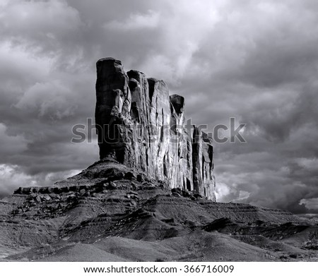 Shot on film, grain apparent, Monument Valley Arizona with evening cloudy skies - stock photo