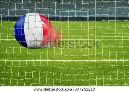 Shot on goal, soccer ball with the flag of France in the net  - stock photo
