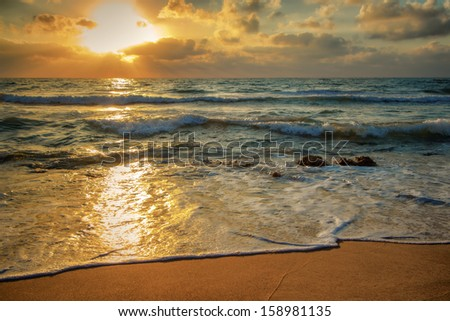 shot was taken when the sun have not quite went away so waves were unusual shine - stock photo