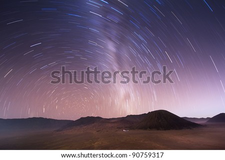 Shot with a long exposure of a rotating stellar sky over Bromo volcano, Indonesia - stock photo