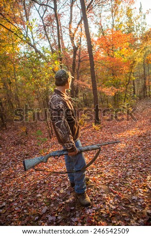 shotgun hunting for deer in a fall forest in geogia
