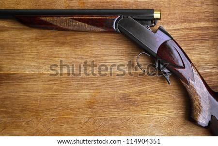 Shotgun on wood - stock photo