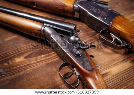 Shotgun on wooden background