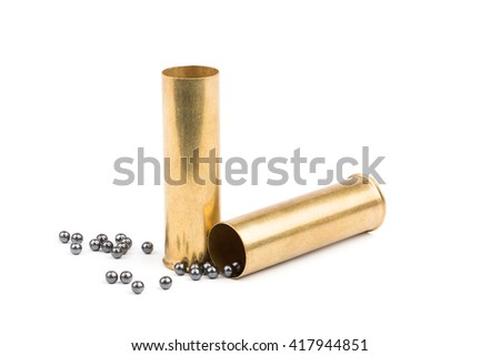 Shotgun shells and scattered iron shot. Isolated on white background