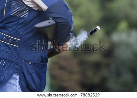 Shotgun throwing its shell - stock photo