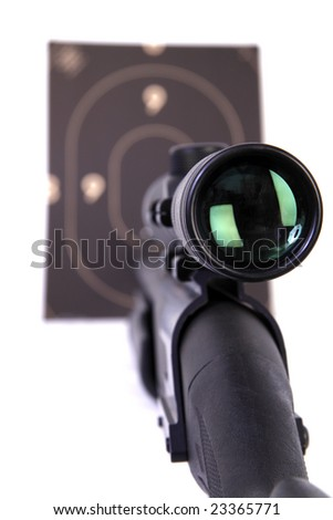 Shotgun with a rifle scope pointing a target . 12 Caliber . selective focus - stock photo