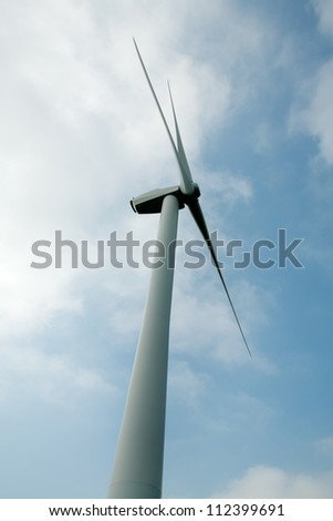 shots of single windmill for renewable energy production in england
