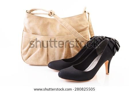 Shoulder bag with high heels - stock photo