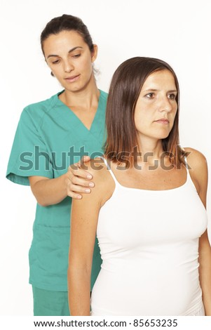 Shoulder inspection by a female doctor - stock photo