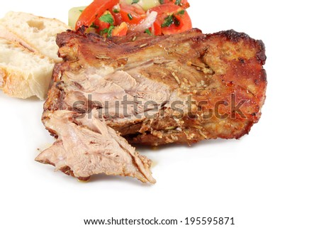 Shoulder of lamb, roasted with herbs - stock photo