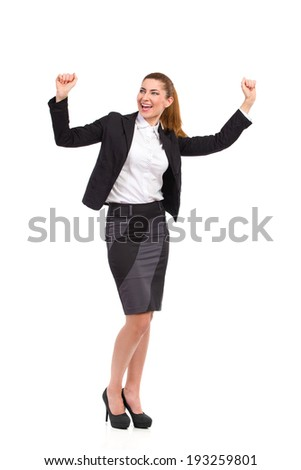 Shouting businesswoman in a black suit raising hands. Full length studio shot isolated on white. - stock photo