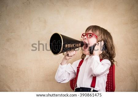 Shouting child businessman with megaphone. Success communication business concept - stock photo