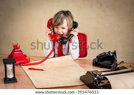 Shouting child businessman with retro phone. Success communication business concept - stock photo