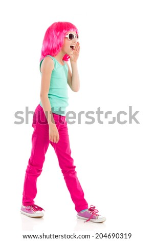 Shouting girl in pink wig. Pink haired girl in sunglasses shouting. Full length studio shot isolated on white. - stock photo