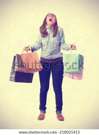 shouting girl with shopping bags. isolated - stock photo