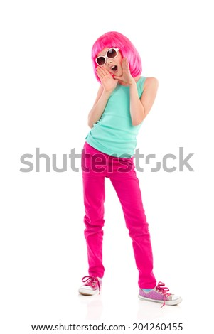 Shouting girl. Young girl with pink hair and sunglasses shouting. Full length studio shot isolated on white. - stock photo