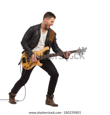 Shouting guitarist in black leather jacket plays the bass guitar. Full length studio shot isolated on white. - stock photo