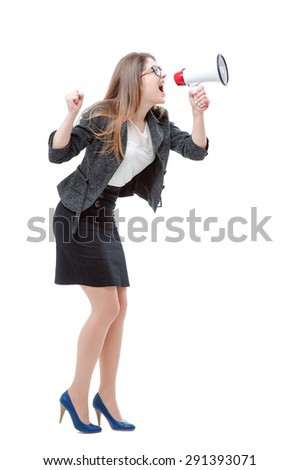 Shouting louder! Full length studio portrait of young business woman using megaphone. Isolated on white. - stock photo