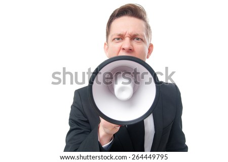 Shouting louder! Studio portrait of young businessman using megaphone. Isolated on white. - stock photo