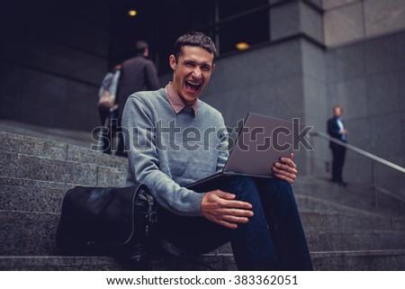 Shouting man using laptop. - stock photo