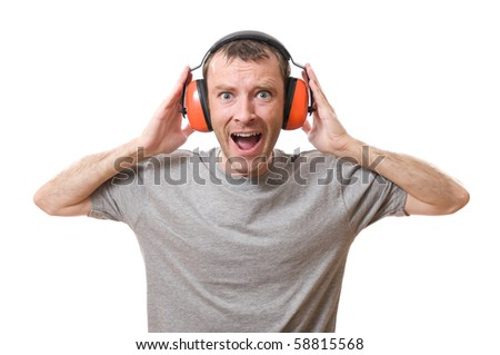 shouting man with ear protection versus loud sound - stock photo