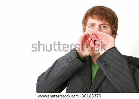 shouting or communicating message. young adult with hands in front of mouth to shout loud - stock photo