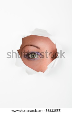 Shouting spying female through white wall - stock photo