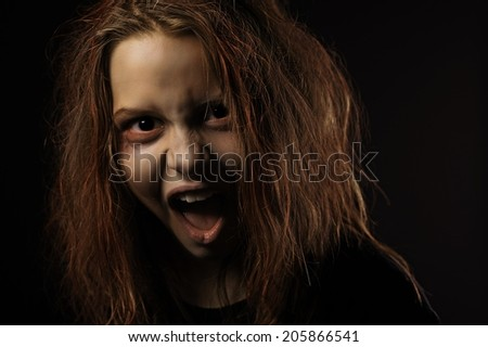 Shouting teen girl possessed by a devil
