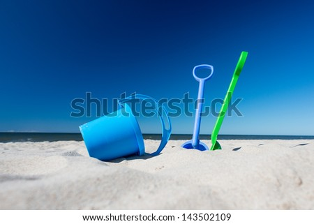 shovel and bucket on the beach - stock photo