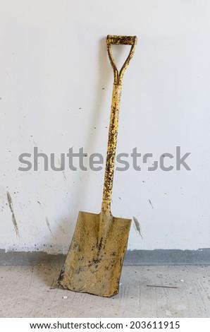shovel at construction site - stock photo