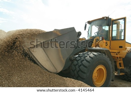 Shovel bucket taking sand