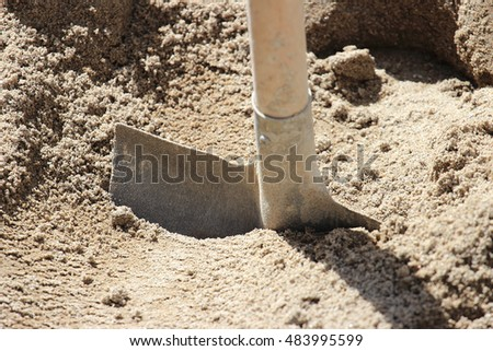 shovel in sand pile on construction site