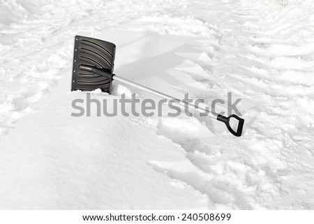 Shovel in snow, outdoors. Focus on hands shovel - stock photo