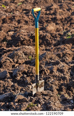 Shovel in the ground. vertical frame - stock photo
