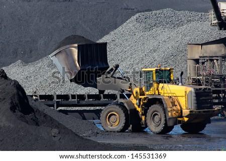 Shovel moving coal - stock photo