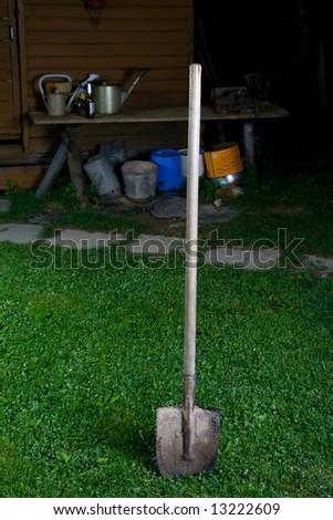 Shovel on a green grass - stock photo