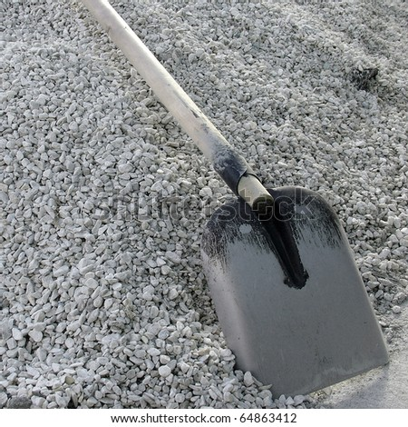 Shovel on a heap of gravel - stock photo