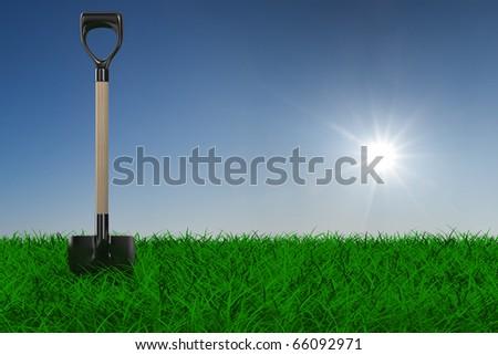 Shovel on grass. garden tool. 3D image - stock photo