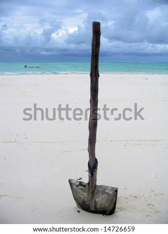 Shovel on Zanibar Beach (Indian Ocean background) - stock photo