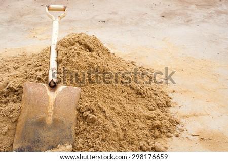 Shovel Sand for Construction - stock photo