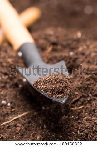 Shovel tool on soil - stock photo