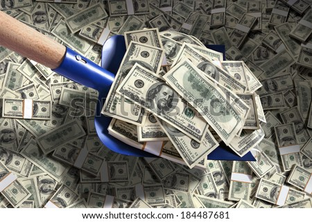 Shovel up money / studio photography of American moneys of hundred dollar  - stock photo