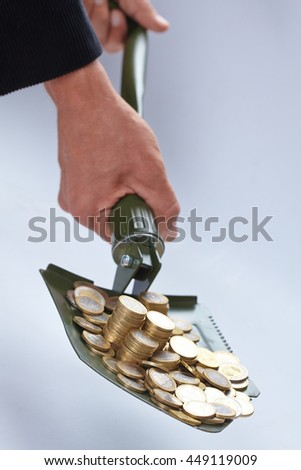 shovel with money - stock photo