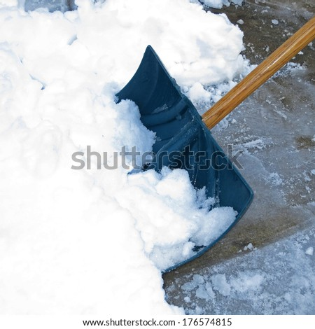 Shoveling snow after a winter storm - stock photo